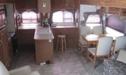 29 foot cougar 5th wheel 2 slides mid entery, island kitchen nice layout , new fridge, hot water tank reduced price and still wish to trade for a camper would be optimal give me a try???? last discount and entery call 250-365-9621