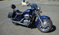 Immaculate 2002 Honda Shadow American Classic Edition.  Only 17000 km., garage stored, excessively well maintained, never dropped and never ridden in the rain.  This bike has windshield, passenger backrest, saddle bags, fork wind deflectors, and cruise