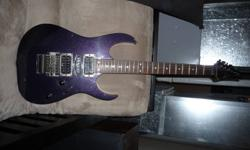 "Looking to sell my 2002 Ibanez RG570 guitar.  Basswood body, rosewood fretboard, original pick ups, double locking tremolo, maple ""super wizard"" neck, ""cosmic blue"" finish.  Made in Japan (way better quality than later Korean models).  It's in amazing"