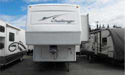 Price: $19,988 Stock Number: I2166 This fifth wheel is in great condition. It has had a new roof membrane, new tires, new fridge and new flooring. It has a large hanging closet all the way across the front in the bedroom. It has space and plumbing for a