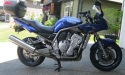 Sport bike performance with all day comfort, new tires, chain, and fork seals. Comes with top box as shown, 53000kms, very clean, runs perfect and everything works as it should. Damage to the tank and fairing shown in the last picture due to a test ride