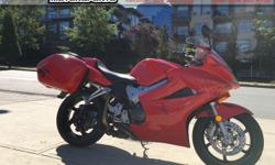 2003 Honda VFR800ABS Sport Motorcycle * Ready to Sport Tour! * $6699. This VFR800 is serviced and ready to ride! Equipped with factory ABS, Factory Hondaline colour matched bags, frame protectors, and sweet sounding Staintune exhaust! Colour: Red. Buy