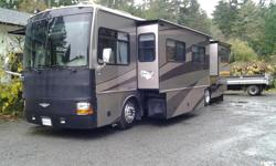 Discovery Motorhome on Freightliner chassis, turbo charger 330 HP C7 Cat Diesel pusher, low mileage 34,0000 miles, 4 slide outs, 2 satellite systems, keyless fob entry, 2 remote powered awnings, power visors, diesel powered generator with approx. 50 hrs,
