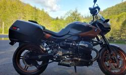 An Incredible bike radical design. Sport Touring 6 speed Shaft Drive Air/Oil Cooled BMW Touring side cases Heated Grips Hand Shields Wind Screen Extended foot pegs Touring Handle bars (also have original bars) Priced for quick sale, local only sale