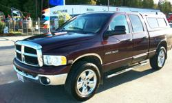 """Make Dodge Model Ram 1500 Year 2004 Colour DARK CHERRY METALLIC kms 290000 Trans Automatic *** 2004 DODGE RAM 1500 """" SLT """" 4 X 4 QUAD CAB !! 5.7 HEMI !! STRONG RUNNER !! *** Here is a good strong running truck, fully loaded , HEMI ENGINE , AUTOMATIC"""