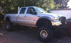 "Make Ford Model F-350 Super Duty Year 2004 Colour Silver kms 227800 Trans Automatic 2nd owner (had since '05) 12"" lift, 40"" tires w/ 80% tread left, diesel, new built up transmission and motor approx 5000 kms ago, 4.30 gears, ARP head studs, EGR delete"