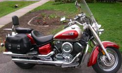 2004 Yamaha V Star 1100.  Mint Condition.  Certified.  Lots of upgrades and throttle lock for those with tendinitis and carpeltunnel.  It is a must see.  It is a deep burgundy and champagne colour.  The pictures do not do justice.  Jacket and helmets