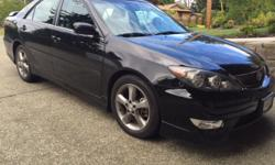 Make Toyota Model Camry Year 2005 Colour Black kms 148000 Trans Automatic V-6, 3.3 litre,225 hp engine, 5 speed automatic w/ overdrive, Stainless steel exhaust, power moon roof, leather heated seats, power everything. This car in excellent shape, never