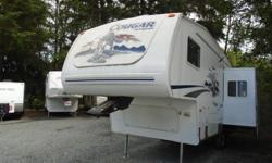 Well maintained rear entertainment Cougar 5th wheel. Clean and bright with loads of storage. Relax in the rocking chairs and eat at the booth style dinette that slides out to maximize interior space. The walk around queen bed gives you easy access and the