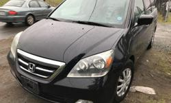 Make Honda Model Odyssey Year 2005 Colour BLACK kms 167000 Trans Automatic Touring Edition Best Vans PERIOD!! * 6 Cyl. 3.5L Automatic Transmission * ONLY 104000 Miles (167000 km's) * Black With Black Leather Interior * Air Conditioning * Heated Leather