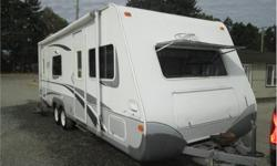 Price: $13,900 front queen bed , rear kitchen , couch slide out