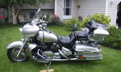 """This is a great touring bike. 1300 V-4 cyl is very smooth with lots of power. Options include:  Electronic Cruise control, 4 speaker AM/FM radio with cassette and MP3 input, CB radio, Driver/Passenger intercom, 12'' and 18"""" windshield, Driver backrest,"""