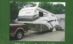5th Wheel with five slides in excellent condition.  Only one owner, no pets, no smoking.  Oak cabinets, central air and vac.  Front leveling jacks.  All season home.  Corian counter tops, auto find satellite receiver.  Custom room to attach to awning.