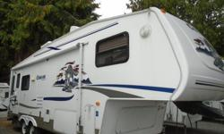 Start creating memories that will last a lifetime in this Cougar 5th Wheel! The Keystone Cougar is a great blend of standards, options, comfort and pricing! This charming rear-living floor plan features single slide, enormous cupboards, closets and