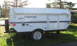 2006 flagstaff 8 foot trailer excellent condition ,new heated mattresses ,also built in cd player and speakers, stove, fridge,sink, new marine battery.and also has a propane furnace and attachable bbq..