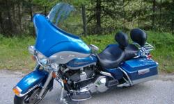 Detachable Batwing Fairing, Detachable Sissy Bar c/w Luggage Rack, Back Rest and Performance Pipes.  Have stock pipes and windshield.  Excellent condition......must see!  $14,500.00 O.B.O.   Phone Bob @ 1-250-229-4112