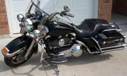 2006 Road King Police, excellent condition, includes windshield, backrest and true dual exhaust.