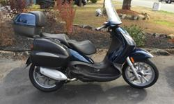 This is a fully dressed from the factory scooter with 12,000 kms 4 stroke engine, highway capable scooter with 2 riders, the bike has all manuals and repair manual 2 sets of keys the tires are excellent and the scooter is ready to ride, superior coverage