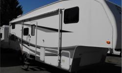 Price: $21,988 Stock Number: I2147 The Terry Quantum is a well appointed Fifth Wheel. This one has a large slide and a separate room in the back with Jack and Jill bunks. Includes awning, microwave, scissor jacks, slide awning and air conditioning.