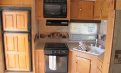 2007 Springdale 25' Travel Trailer, Model #250 RKL-S Very clean, well cared for, 1 owner. Walk around Queen Bed with large storage, Slide with Sofa Bed, 3 piece Bath, Corner Design Kitchen, Microwave, Dinette converts to Bed, 2 Entrance Doors, Awning,