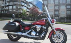 2007 Yamaha XVS1300 V Star Tourer. * REDUCED PRICE !! * $6499. Very nice condition. No accident history. Red and completely stock. Touring model equipped with Windshield, Backrest, and Leather wrapped and locking saddlebags. Buy with confidence from a
