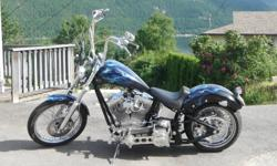 -soft tail -113 cubic inch ultima w/ 6 sped tranny -250mm rear tire -belt drive -perfect shape with only 3200 km!!! -removable passenger seat and pegs -very loud and fast -beautiful paint job I dont want to sell this bike one bit but financially I must!