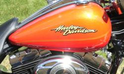 2008 Harley Road King Classic custom colour Show Bike with Harley extended warranty,  Leather Bags and Trunk, Warranty,  ABS,  mint condition never smoked in. I have lowered the price till Christmas only $2800 below book value. Someones going to own a