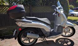 For sale is a 2008 Kymco 50cc 4 stroke People S scooter. Includes add-on's: carrier with value of $80 capable of holding laptops, 2 bags of groceries, and a complete cover for the scooter, valued at $65 and a barely used full face mask helmet valued at