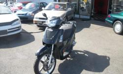 ** Moving Sale, Lease Expired, ALL Inventory Must GO! ** 2008 Kymco People S 125. Looks sharp in black with silver accents and patterned black seats. Lots of features including; Telescopic front forks and dual rear shocks and adjustable rear suspension 5