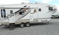 Very bright, clean and well maintained 5th wheel. Spacious living areas complete with hide-a-bed, good storage and popular amenities. Ask about our RV financing, and we do complete inspection prior to delivery! Special Features: Exterior shower, queen