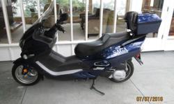 Benzou Sega scooter for sale. 250 c.c. Gas powered. Low mileage ( 5,000 ) Professionally serviced June / 16. Dark blue color. large back compartment. Was involved in minor, low speed, 'layover' incident hence the low asking price. All broken parts