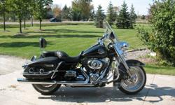 2009 Harley Davidson Road King Classic. $8,000+ in Harley Davidson upgraded accessories including Sundowner seat, driver's backrest, passenger backrest, luggage carrier rack, Screaming Eagle exhaust, chrome master brake resevoir and levers, stainless