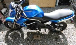 ER6N - The N stands for naked. This is for the serious sport rider who wants a light, nimble, fast machine without a lot of bells and whistles to weigh them down. This is a beautiful bike with only 2200 kms on it. (I have several motorcycles, and because