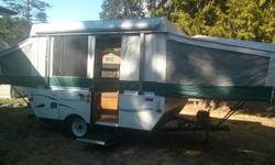 Virtually brand new (only two trips) 2010 Coleman Yuma Tent-trailer looking for new adventures. King size main bed, queen size secondary bed and a collapsible kitchen table drops down to become a child's bed. Technical Specifications: Length (closed)
