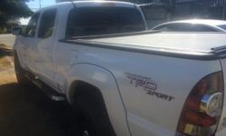 Make Toyota Model Tacoma Colour White Trans Automatic 4x4 TRD Sport Toyota Tacoma has 139,500km, grey leather interior, heated front seats, rear view back up cam,6 cd disc changer,AC,Cruise Control,Easy to change into 4x4 High/4x4 Low ,Had new tires