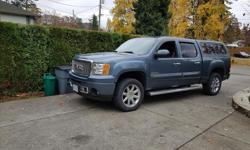 Make GMC Year 2011 Colour stelth gray blueish Trans Automatic Denali AWD crew cab short box with 49,000 km,6.2 gas motor,6 speed,trailer package,full load less sunroof and nav, had 1 accident-replaced complete front bumper,icbc. 20 inch wheels, 342