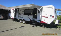 28.5 ft, front kitchen, separate bedroom, power awning, power lift hitch, super slide, hide-a-bed, 8 cubic ft fridge, booth dinette sleeper, new condition. GVWR - 11,776 lbs, cargo carrying capacity - 3,437 lbs. This unit is comfortable for short hauls,