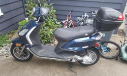 Open to offers. Great scooter with just over 5000 KMS on it. Starts great. Oil changed regularly, even though it didn't need it, and run regularly to keep in good shape. Minor scratches and one misshapen but usuable brake handle from when it fell over