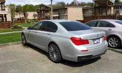 Make BMW Model 750i Year 2012 Colour Silver kms 40000 Trans Automatic 400HP 4.4L V8 6 Speed Auto/Steptronic Transmission M-Sport PKG Executive PKG Front & Rear Heated & Cooled Seats 4 Zone Climate Controls Ceramic PKG (Ceramic Shifter, iDrive & Audio