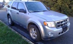 Make Ford Year 2012 Colour Grey Trans Automatic kms 215000 The Ford Escape is a compact crossover that has enough room to haul around a small family. 2.5L 4CYL automatic, power locks, power windows, dual a/c, alloy rims, cruise, power driver seats, AM/FM