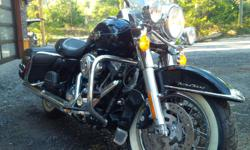 i have a mint 2012 road king for sale, its got 6000 km on it and is bone stock. leather bags on sides, alarm and keyless remote. this bike also comes with 3 helmets, charging system, and harley cover. black on black, runs perfect, never dropped. looking