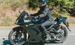 """Riding season is here! 2012 Black Ninja 250, 6300km, garage kept, lady ridden. Torque-y little bike that keeps up on the highway and looks like a much bigger bike! Super fun, sporty. and efficient way to get around. Lowered to fit someone 5'0"""", but comes"""