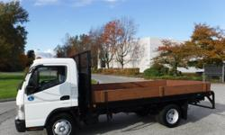 Make Mitsubishi Year 2012 Colour White Trans Automatic kms 69916 Stock #: BC0030579 VIN: JL6CRE1A4CK000414 2012 Mitsubishi Fuso FE180 14 Foot Flat Deck Dually Diesel, 3.0L, 4 cylinder, 2 door, automatic, tiptronic transmission, 4X2, white exterior, blue