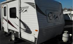 """Price: $15,988 Stock Number: I2209 Canyon Cat Travel Trailer by Palomino RV w/Rear Corner Bath Including: 38"""" Tub w/Dome & Toilet, Closet, Side Sofa w/Overhead Storage, Front Booth Dinette, Sink, 2 Burner Cooktop, Refrigerator Below Kitchen Counter,"""
