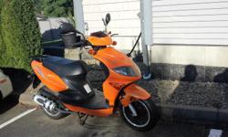 2,560 kms.Has windsheild and white medium sized helmut. Metalic orange ,very good condition. Original owner