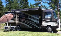 PRICED TO SELL Gently Used, LIKE NEW 2013 Daybreak A Class 6,267 Miles Ford V-10 Engine Diamond Coat Protection Sleeps 2-4 comfortably Two Slides - Kitchen & Bedroom Seperate Shower Two Flat Screen TV's, DVD Player Large fridge Walk around Queen Size Bed