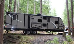 2013 Dutchmen Kodiak 276 BHS Travel Trailer. Double slides, double bunks, separate queen bedroom with a sliding door, bathroom with bathtub and a separate entrance, kitchen island with a double since, outdoor bar fridge, flat screen TV, brand new golf