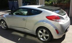 """Make Hyundai Model Veloster Year 2013 Colour Silver kms 48000 Trans Manual Fun Car and great on Gas. $40 gas gets you 2 weeks. Still 2+ years left on Factory Warranty.$12,250 OBO Power everything, Push Button start, heated seats, 7.5"""" audio system,"""