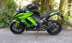 2013 Kawasaki Ninja 1000 with ABS. Mint condition Approximately 7000km Priced below value - need to sell. Adjustable windscreen - for rain or sport mode. Not a scratch, never dropped, never red-lined Aftermarket 'Sato Racing' frame sliders (the best -