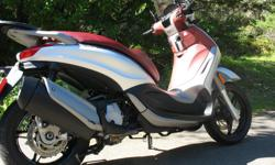 "2013 Piaggio BV 350, like new condition at 5,300 km, aftermarket Givi windscreen & tail trunk. Highway capable with a top speed of 140 km/hr. Rides with more stability, control & better handling than other scooters due to 16"" front wheel. A fuel injected,"